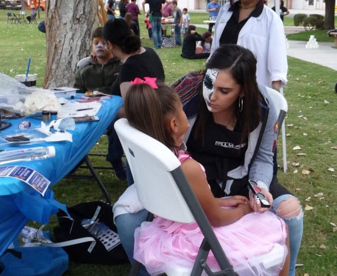 Children get their faces painted at a Halloween-themed get-out-the-vote rally Oct. 30 in Las Cruces hosted by teachers union National Education Association — Las Cruces.