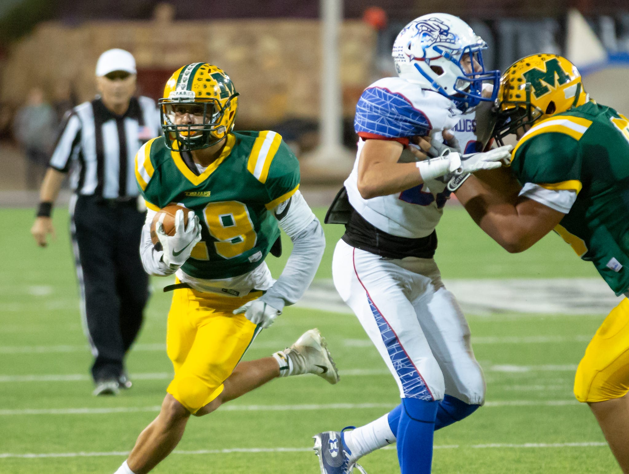 Aaron Thompson runs with the ball during the Cruces/Mayfield football game on Friday, Nov. 2, 2018, at Aggie Memorial Stadium.