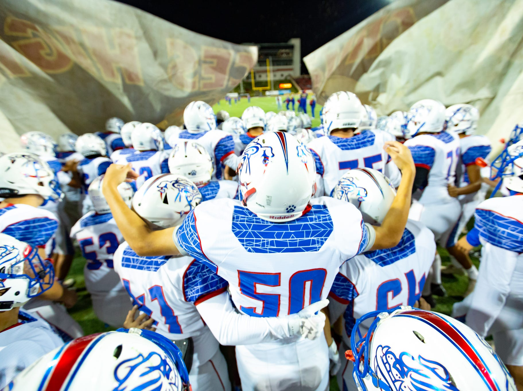 Las Cruces High School football players take the field during the Cruces/Mayfield football game on Friday, Nov. 2, 2018, at Aggie Memorial Stadium.
