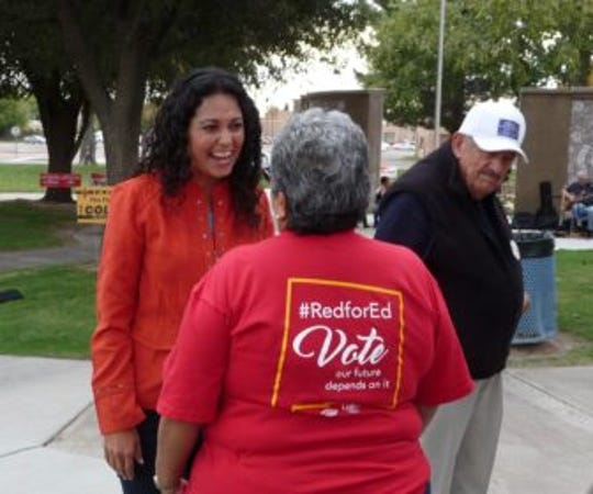 Democratic candidate for Congress Xochitl Torres Small speaks with a potential voter at a get-out-the-vote rally Oct. 30 held by the National Education Association-Las Cruces.
