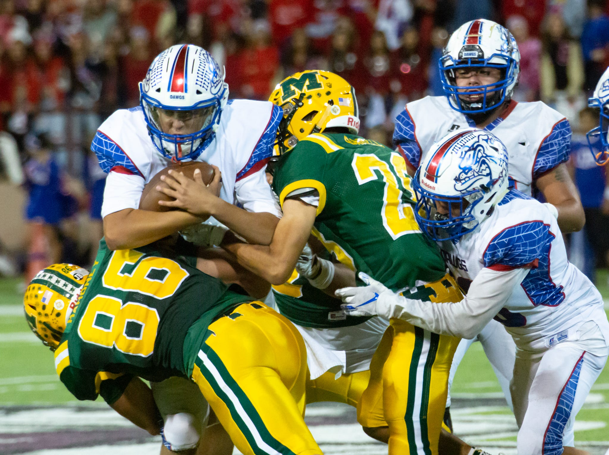 Players firght for a win during the Cruces/Mayfield football game on Friday, Nov. 2, 2018, at Aggie Memorial Stadium.