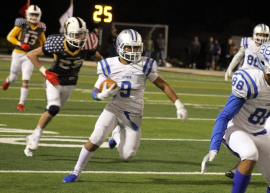 Elijah Etheridge looks for running room after intercepting a Hobbs pass during Friday's game. He finished with two interceptions in the game.