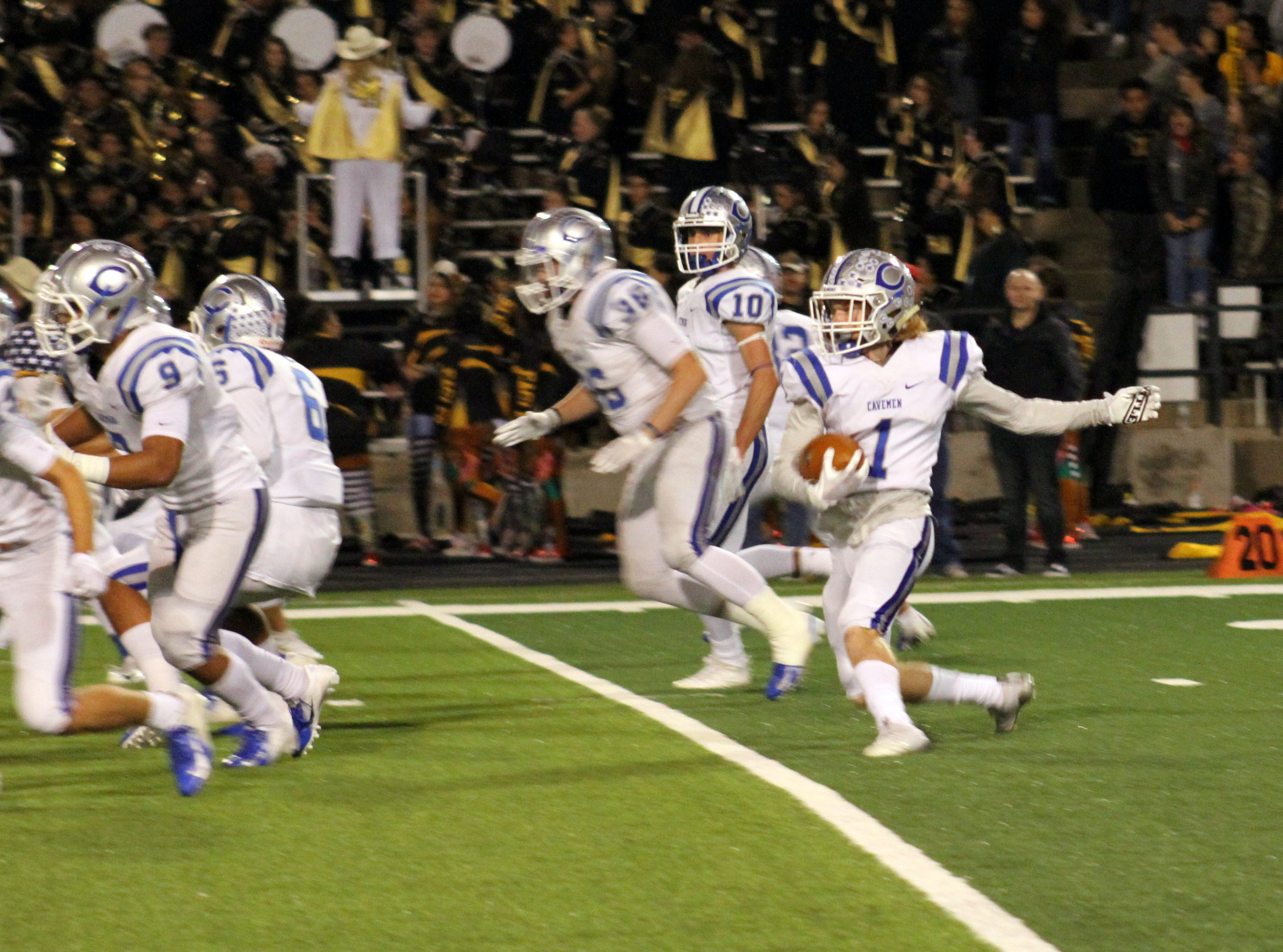 Dustin Eaton (1) stutter steps on a kickoff return while his line sets up blocks during Friday's game against Hobbs.