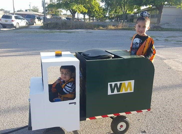 JerseyJo Martinez (left) and her brother Jermaine team up driving a garbage truck for Halloween.