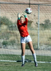 Patti Oliver makes one of her nine saves during Saturday's match against Volcano Vista.