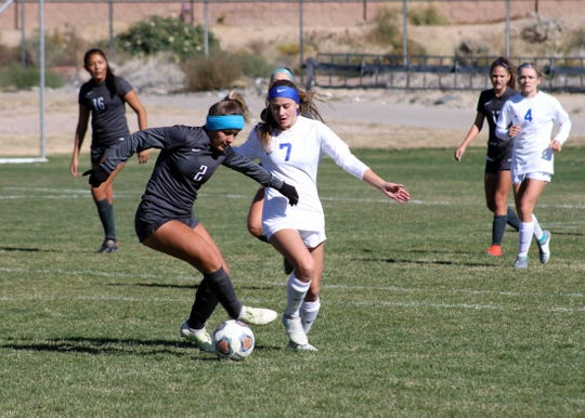 Saydie Bickerstaff fights for possession in the first half of Saturday's game against Volcano Vista.