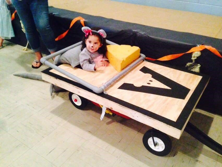 JerseyJo Martinez rides on a mobile mousetrap built by her father as a Halloween costume.
