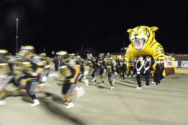 The Alamogordo Tigers rush out onto the field for their game against the Artesia Bulldogs, the last game of the 2018 season.