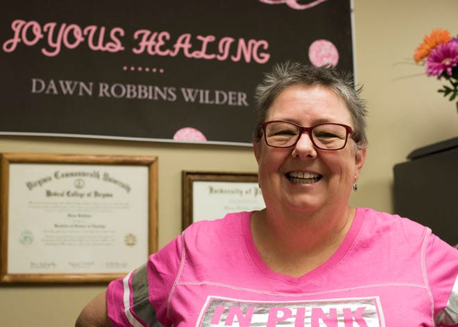 Dawn Wilder, 49th Medical Group quality and risk manager, poses for a photo October 25, 2018, at Holloman Air Force Base, N.M. Wilder was diagnosed with breast cancer in 2015, and is celebrating her third year of being cancer free.