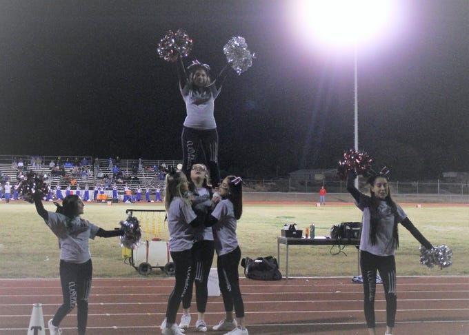The Tularosa Wildcat Cheerleaders perform an extension during the Wildcats game against the Dexter Demons Friday night.