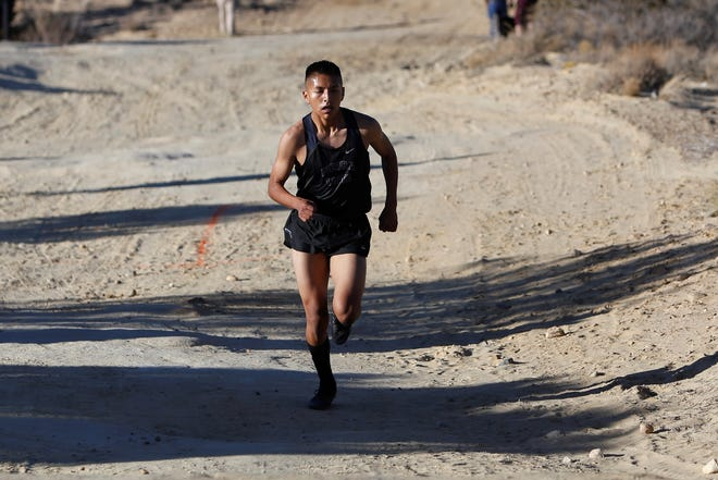 Piedra Vista's Triston Charles darts up the trail during the District 2-5A cross-country championships Friday at Pinon Hills Community Church in Farmington. Visit daily-times.com to see more images.