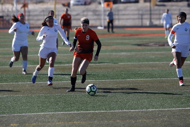 Aztec's Alanna Larkins moves the ball downfield against Santa Teresa during Saturday's 4A girls soccer playoff opener at Fred Cook Stadium in Aztec.