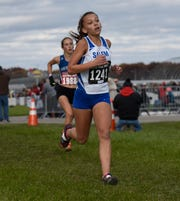 Salem's Reagan Justice during the Division 1 2018 cross country finals at Michigan International Speedway.