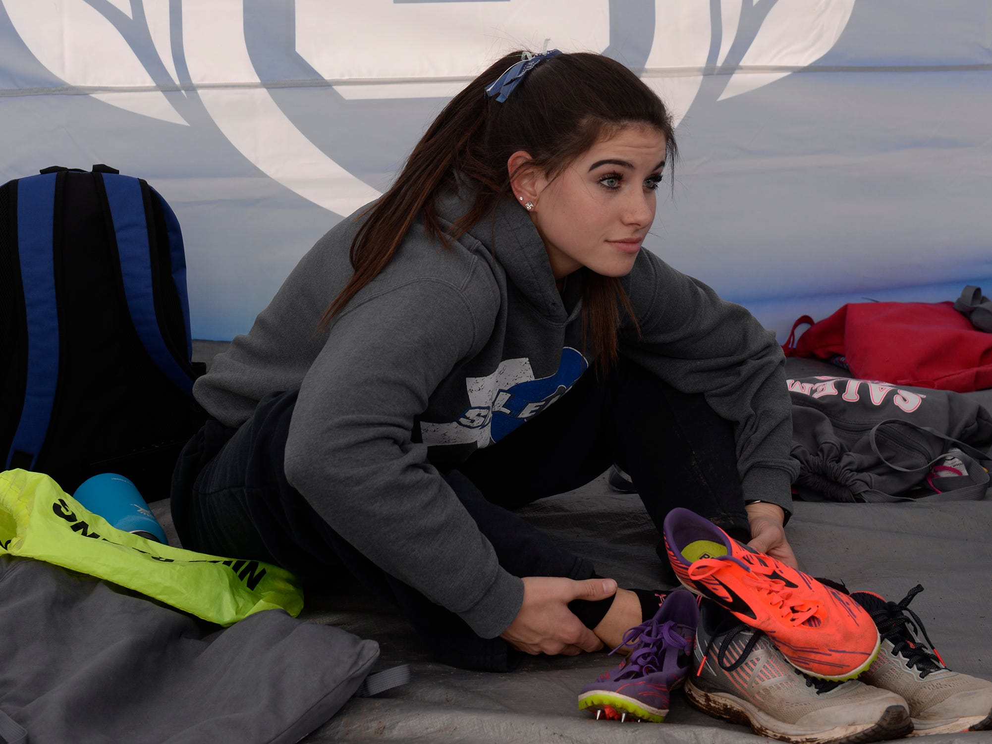 A Salem runner gets ready for the Division 1 2018 cross country finals at Michigan International Speedway.