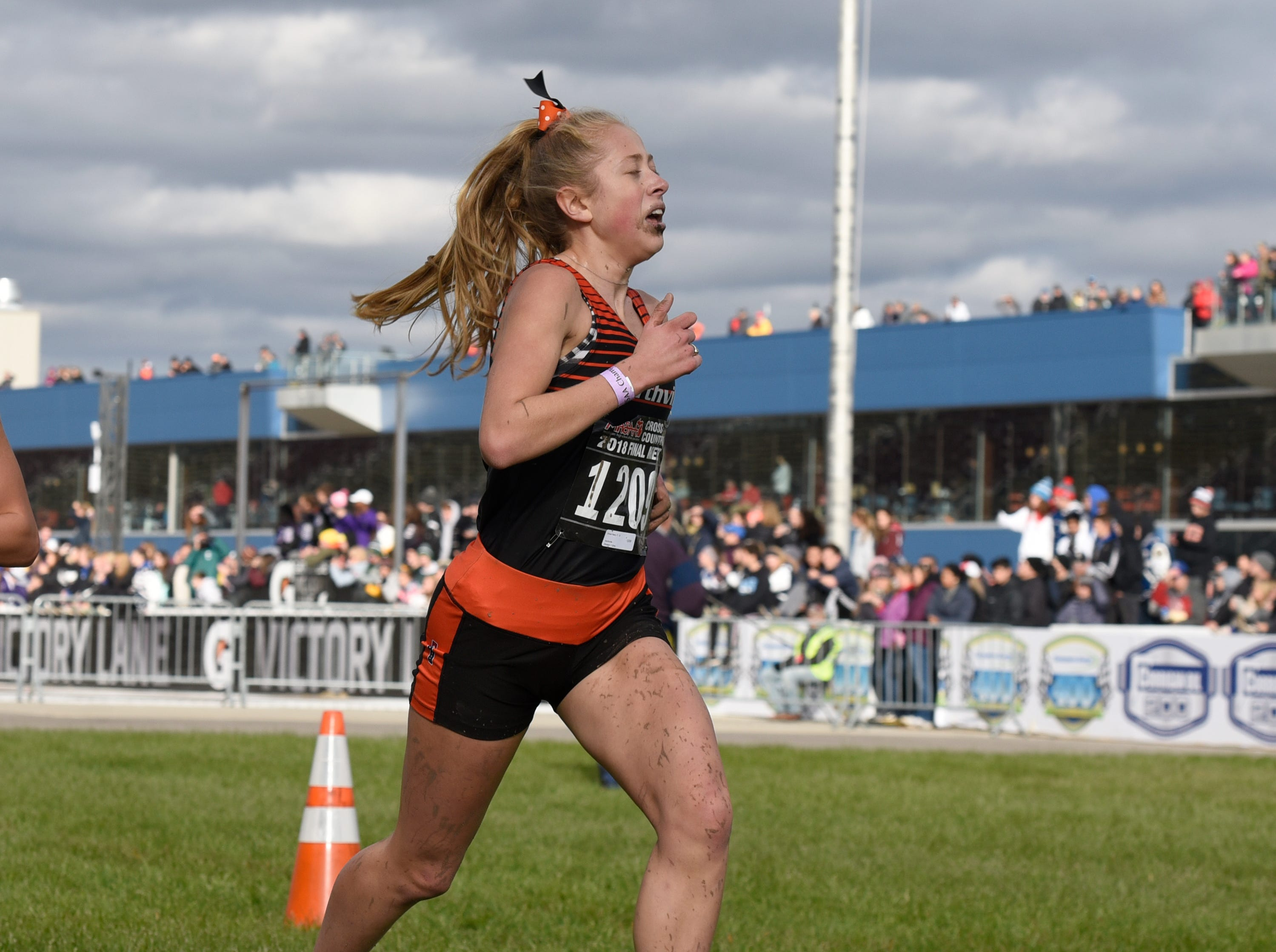Northville's Olivia Harp during the Division 1 2018 cross country finals at Michigan International Speedway.