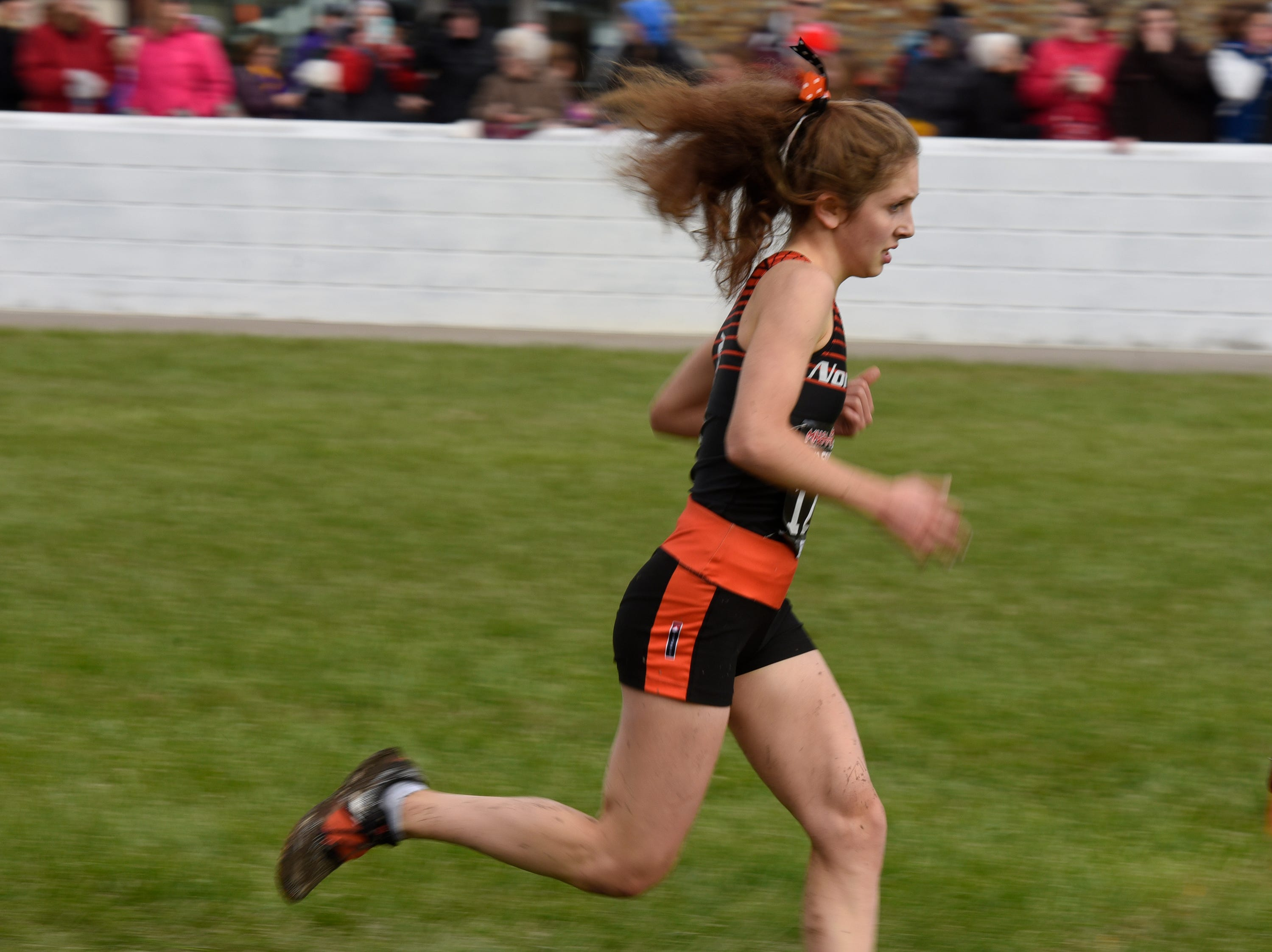 Northville's Emma Munro during the Division 1 2018 cross country finals at Michigan International Speedway.
