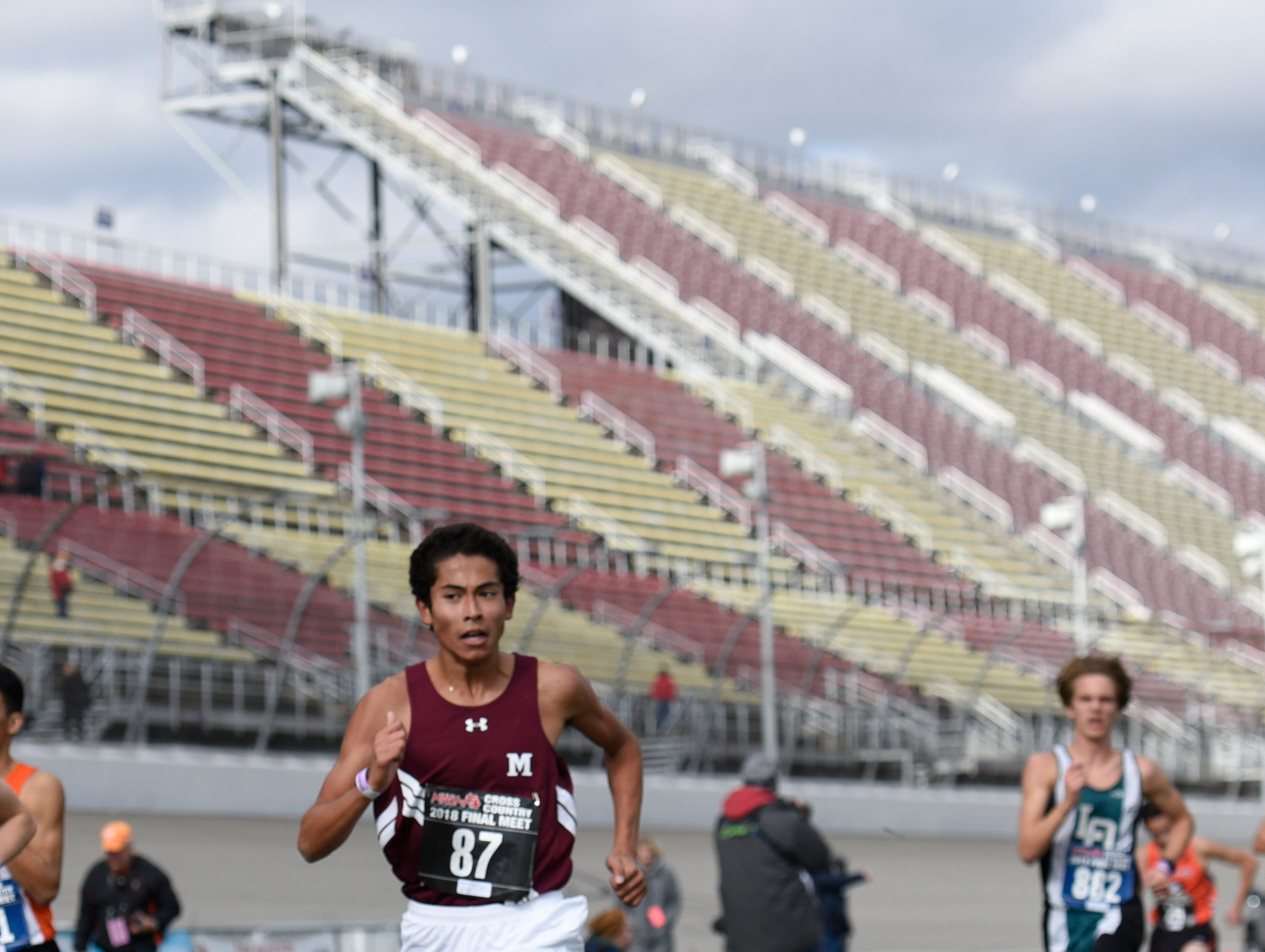 Milford's Kazuma Bowring during the Division 1 2018 cross country finals at Michigan International Speedway.