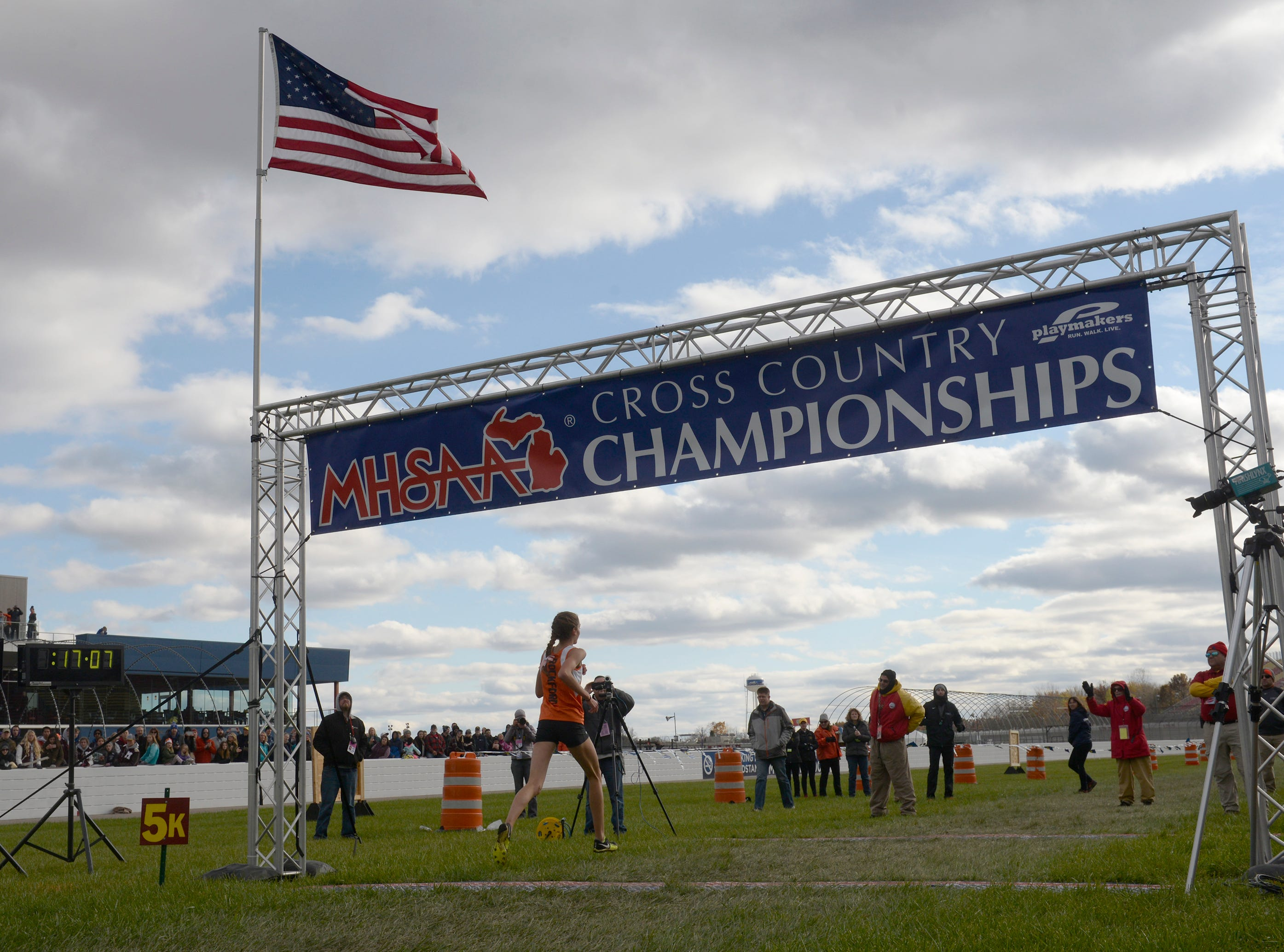 Rockford's Erika VanderLende crossed the finish line in 17:08.4 to win the Division 1 2018 cross country finals at Michigan International Speedway.