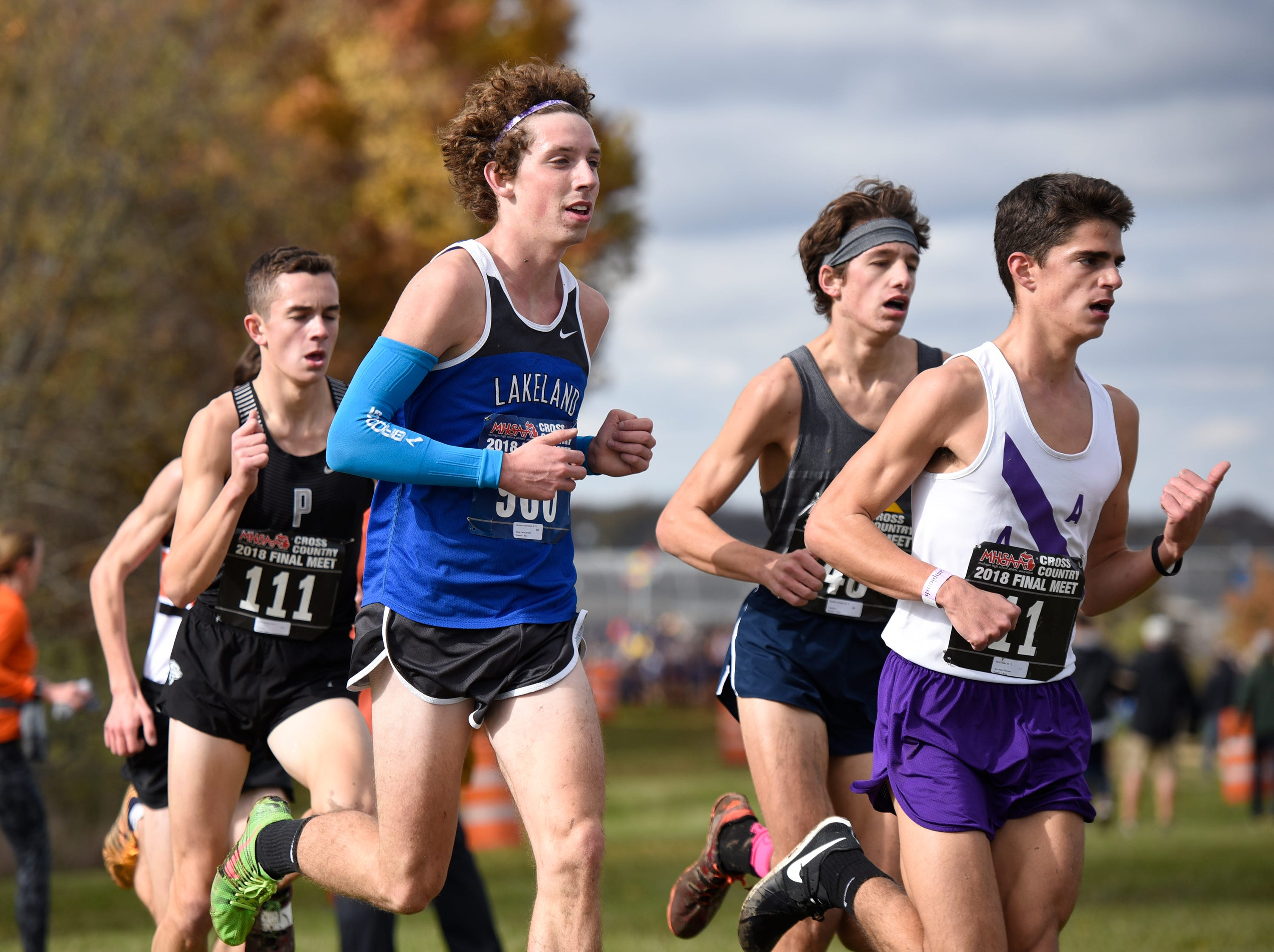 Lakeland's Harrison Grzymkowski in the lead pack during the Division 1 2018 cross country finals at Michigan International Speedway.