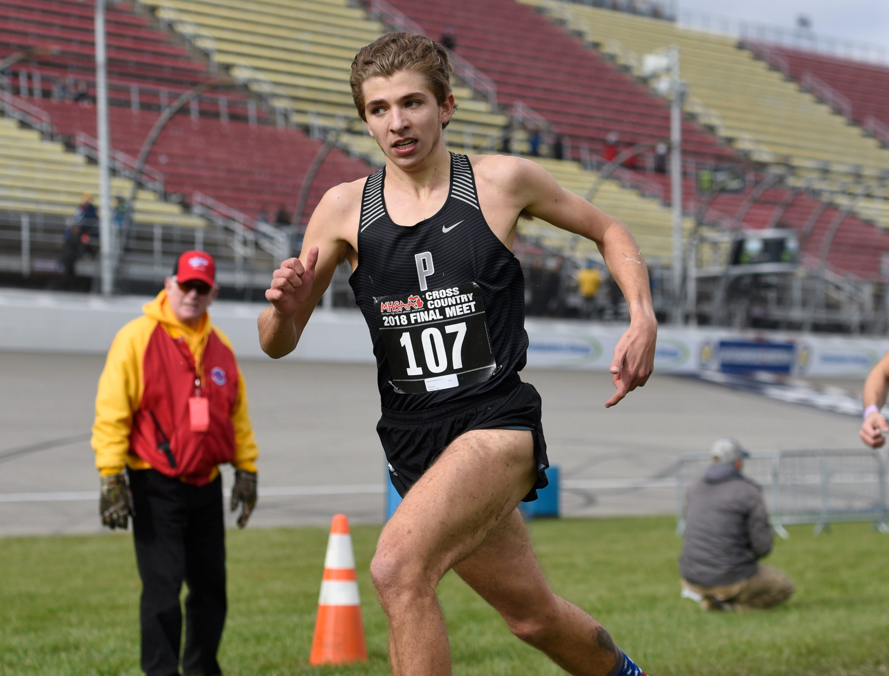 Plymouth's Brandon Boyd (107) helped his the win the Division 1 2018 cross country finals at Michigan International Speedway.