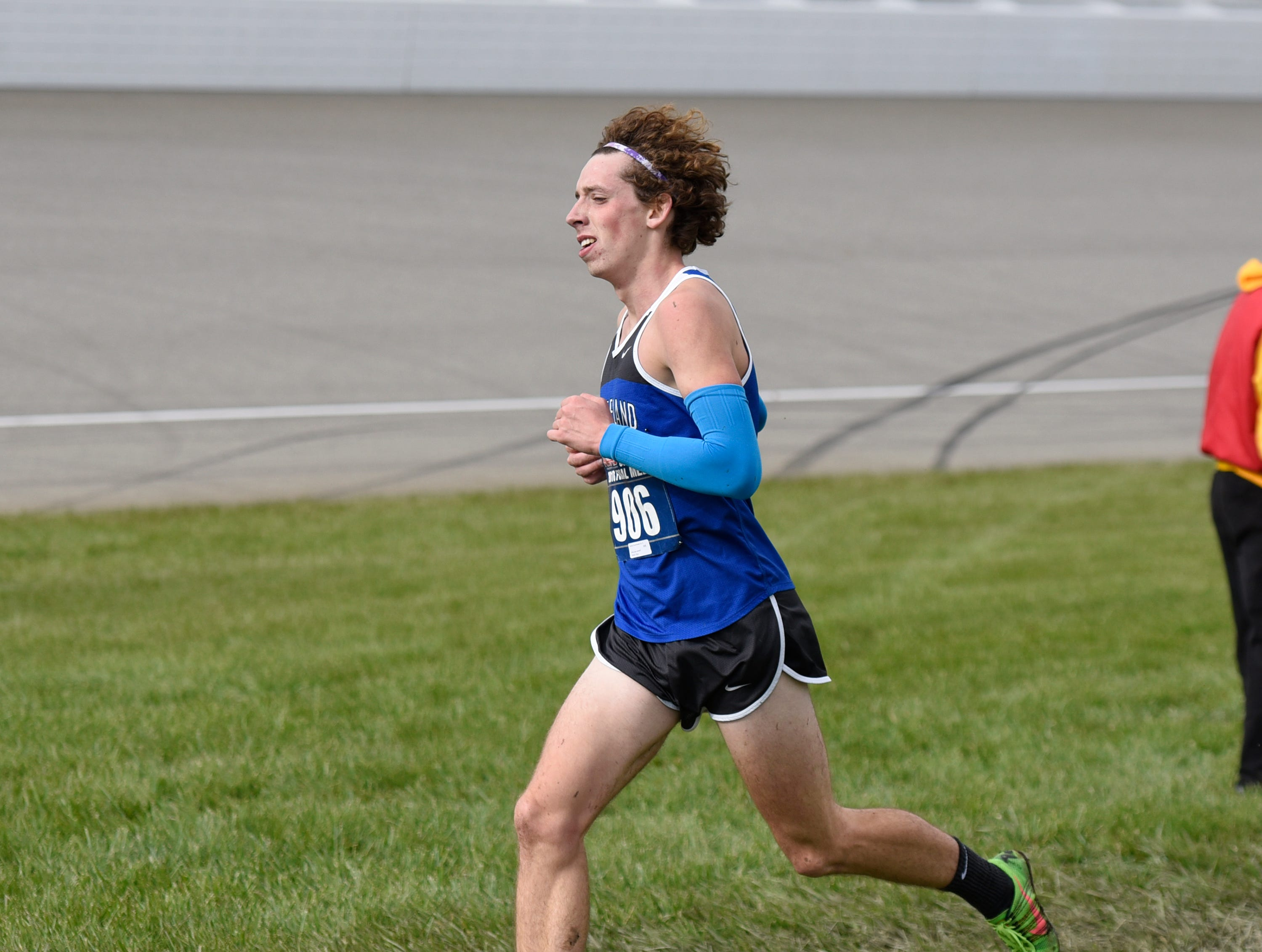 Lakeland's Harrison Grzymkowski running down the stretch for third place in 15:32.3 during the Division 1 2018 cross country finals at Michigan International Speedway.