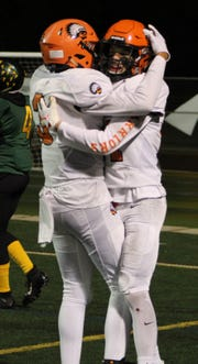 Brother Rice's Patrick Balow (right) celebrates a fourth-quartet touchdown with teammate DaRon Gilbert in Friday's loss to Birmingham Groves.