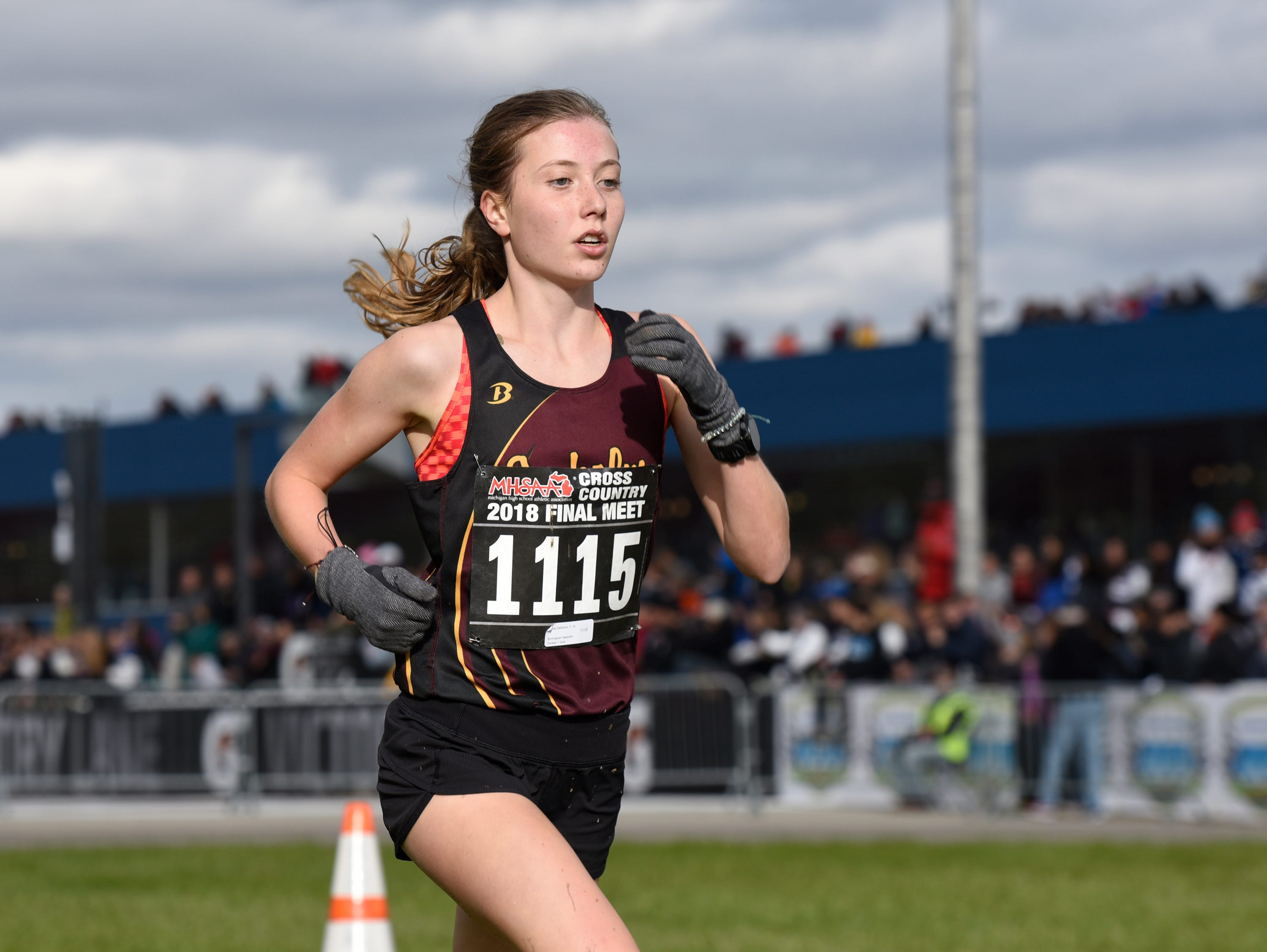 Birmingham Seaholm's Audrey DaDamio during the Division 1 2018 cross country finals at Michigan International Speedway.