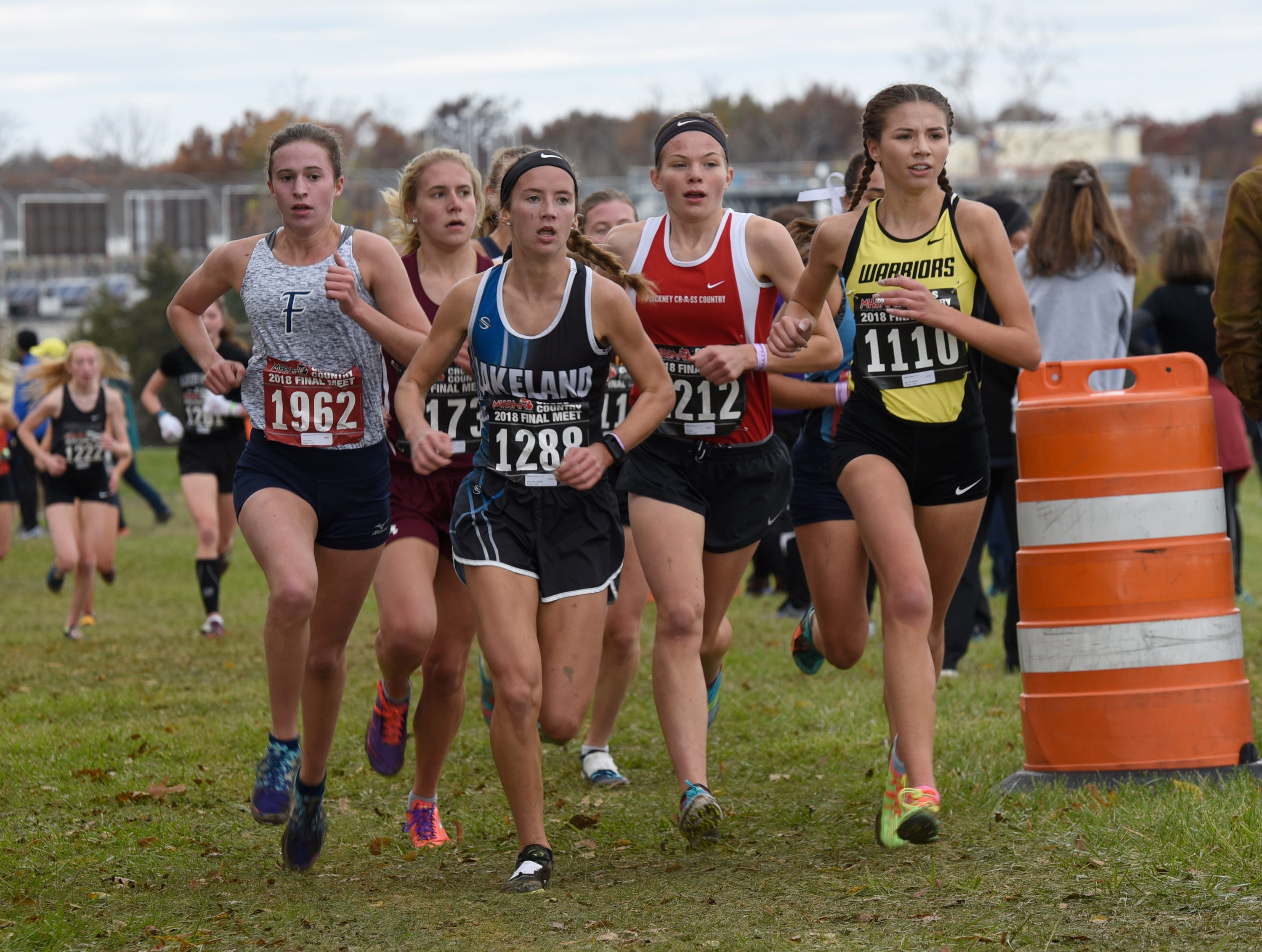 Lakeland's Madeline Rehm (1288) during the Division 1 2018 cross country finals at Michigan International Speedway.