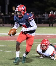 Franklin's Fredrick Biles (8) makes the run after the catch against Temperance Bedford.