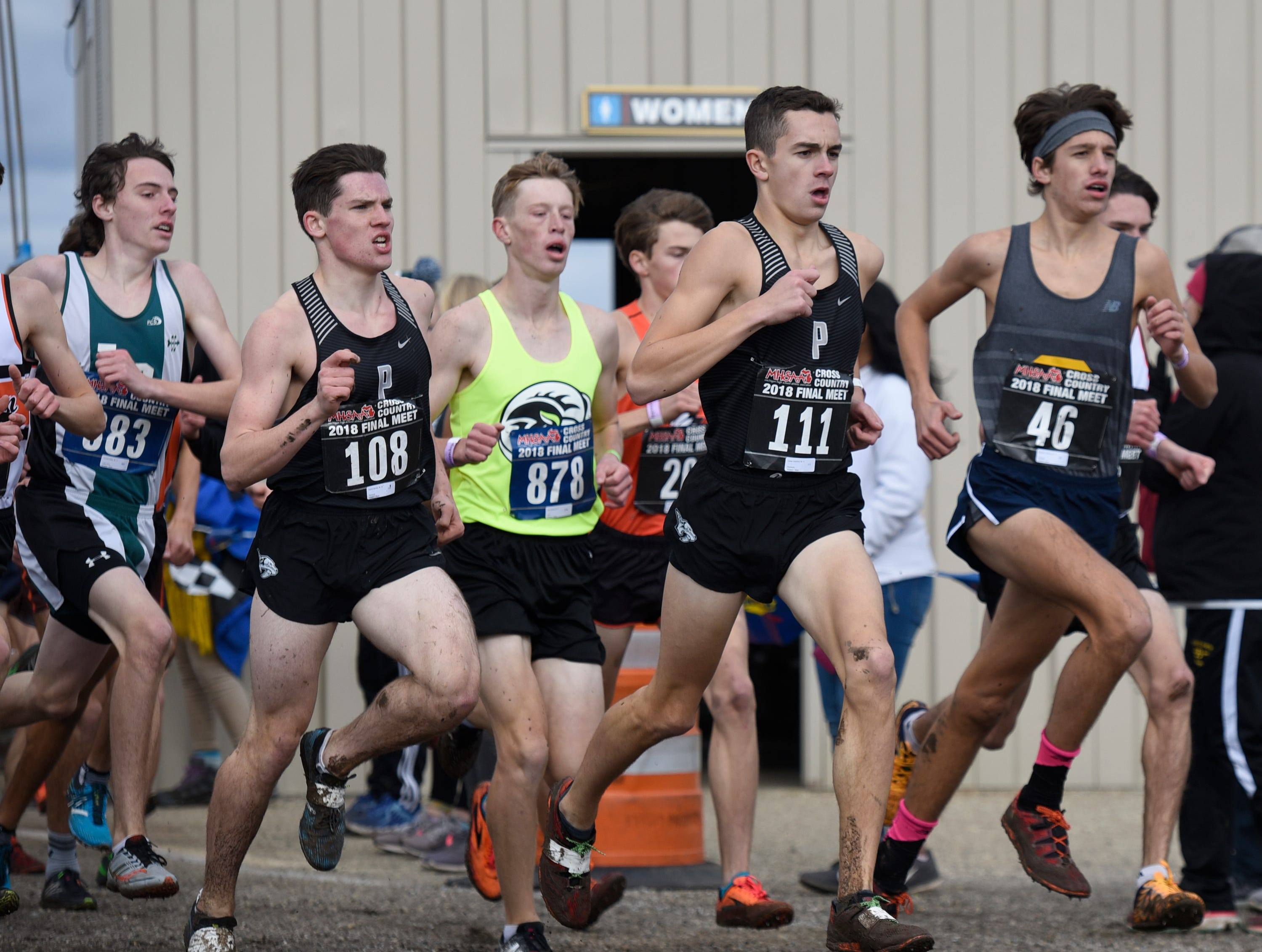 Plymouth's Patrick Barnes Division (108) and Carter Solomon (111) during the Division 1 2018 cross country finals at Michigan International Speedway.