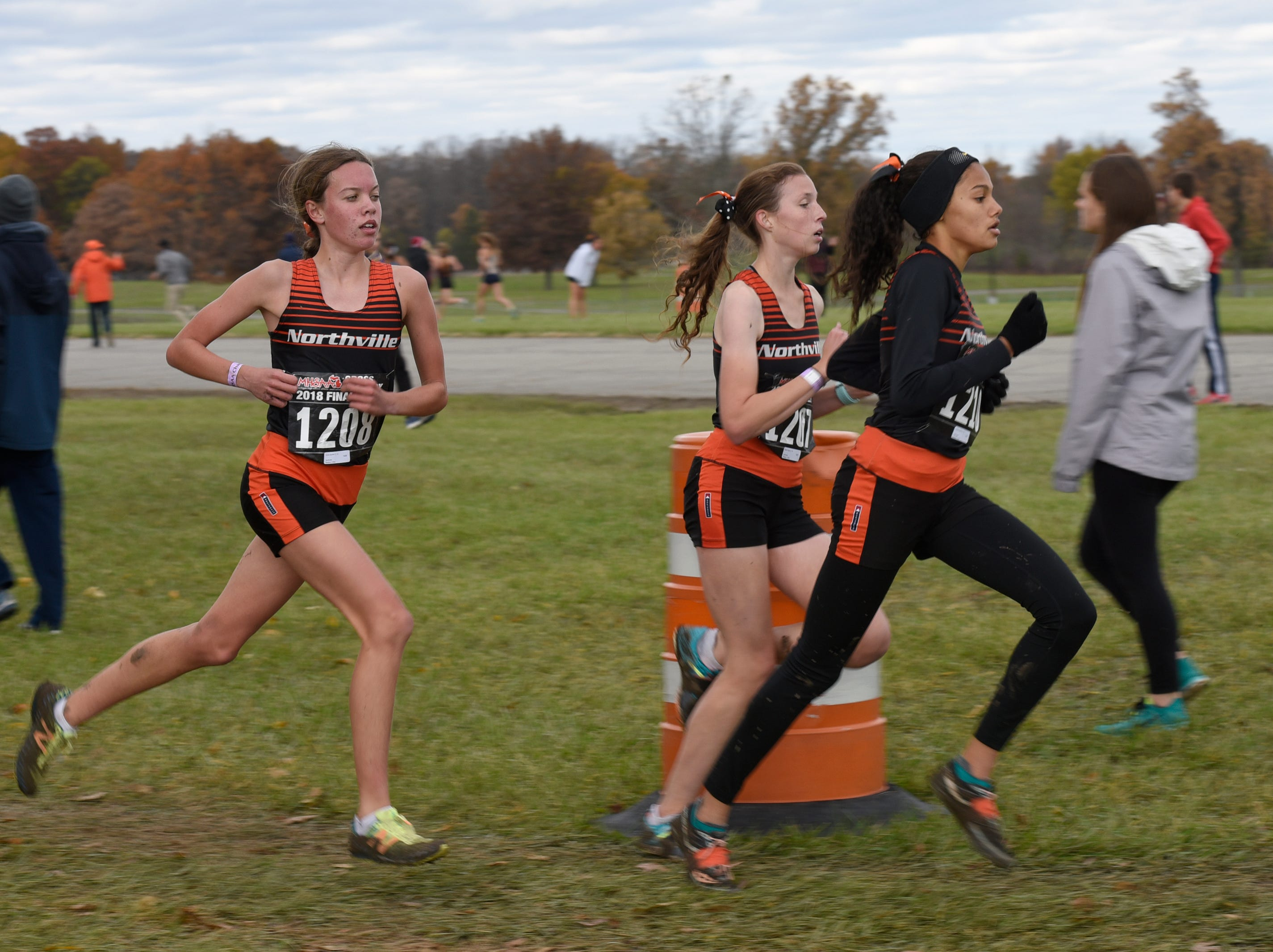 Northville's Emily Gordon, Nicole Cybul, Yasmine Mansi durng the Division 1 2018 cross country finals at Michigan International Speedway.
