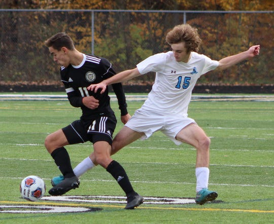 Country Day's senior midfielder Gabe Akeel  (11) takes the ball way from Forest Hills Northern's Will Patrick (15) in Saturday's Division 2 state championship game.