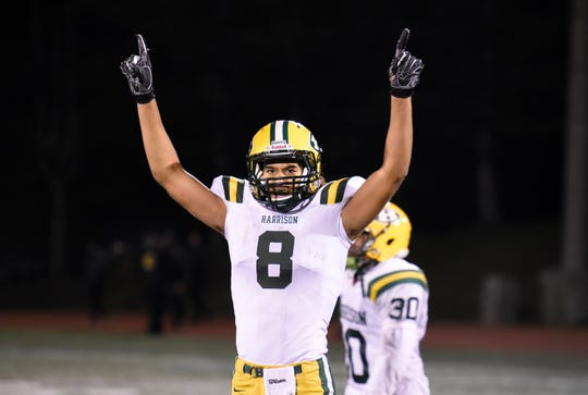 Farmington Harrison QB/DB Max Martin (8) celebrates after catching the winning TD in overtime to extend the Hawks season after defeating Detroit Country Day 13-10.
