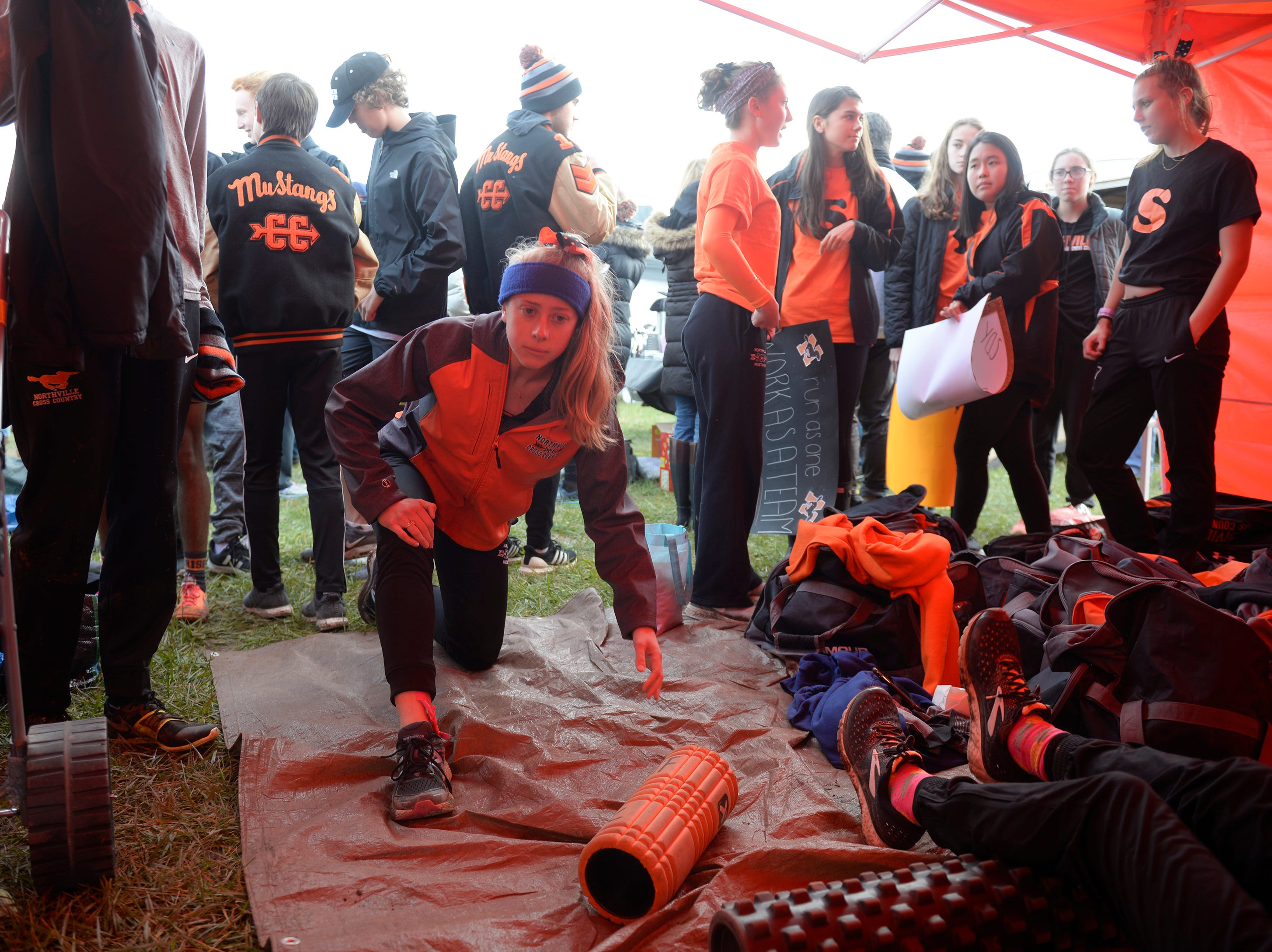 Northville runners warm up before the Division 1 2018 cross country finals at Michigan International Speedway.