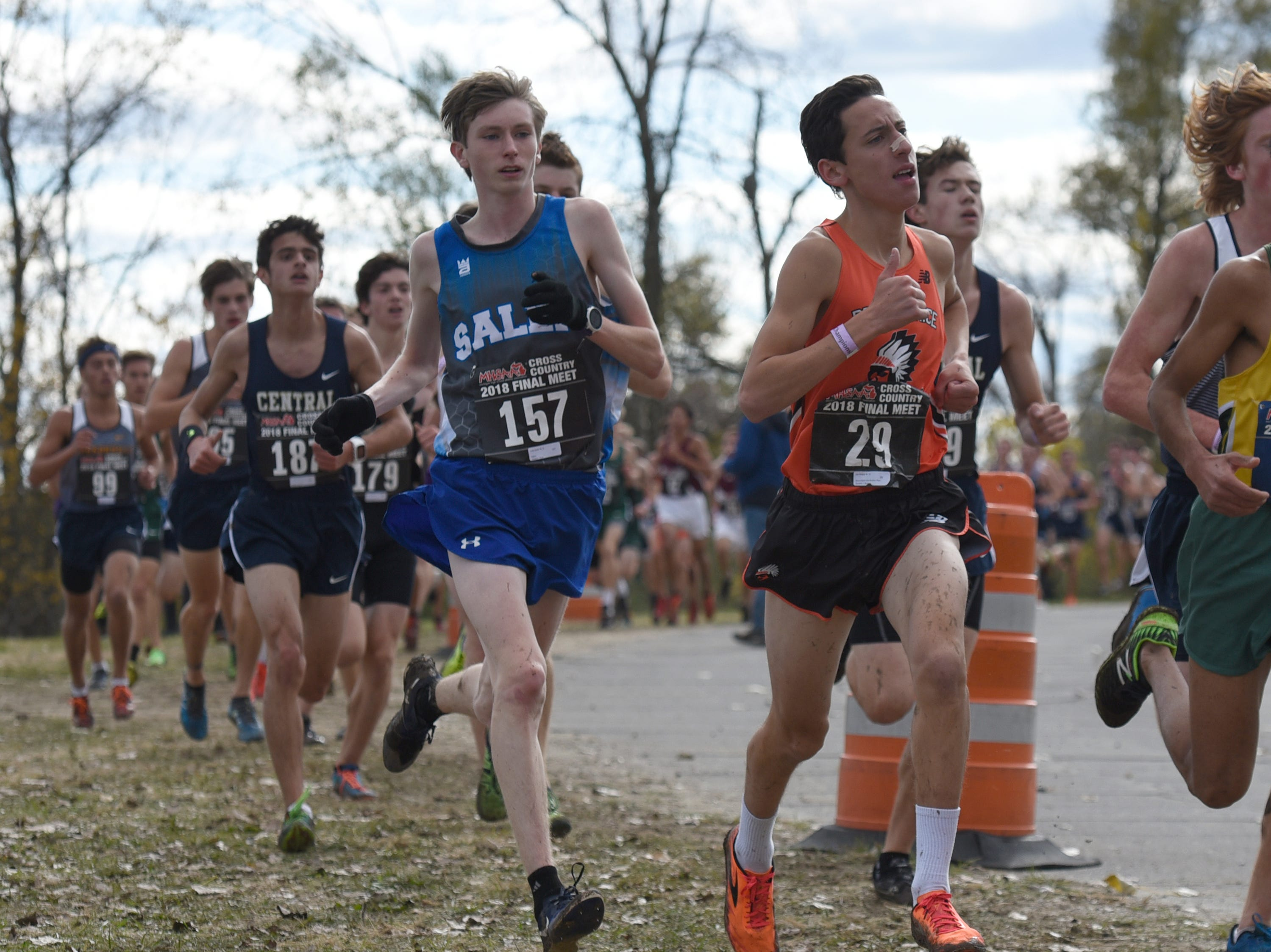 Salem's  Luke Haran (157) and Brother Rice runner Joe Shaya (29) during the Division 1 2018 cross country finals at Michigan International Speedway.