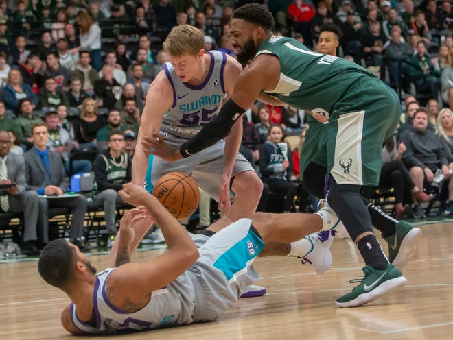 James Young of the Wisconsin Herd disrupts Greensboro Swarm's JP Macura attempt to claim the loose ball at the Menominee Nation Arena Friday, November 2, 2018.