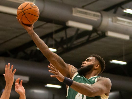 Cinmeon Bowers of the Wisconsin Herd lays up a shot during a Nov. 2 game at the Menominee Nation Arena in Oshkosh.