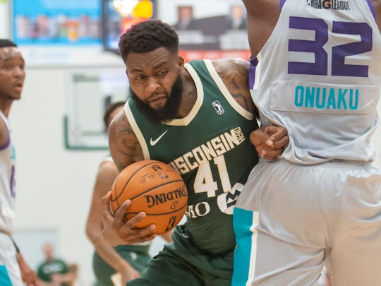 Cinmeon Bowers of the Wisconsin Herd drives around the Greensboro Swarm's Chinanu Onuaku at the Menominee Nation Arena on Nov. 2.