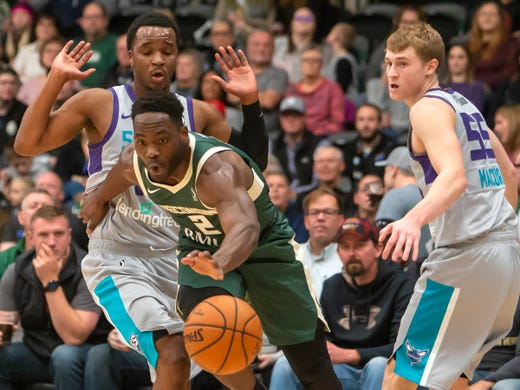 ee42c3160 Ike Nwamu of the Wisconsin Herd reaches for the loose ball playing against  the Greensboro Swarm