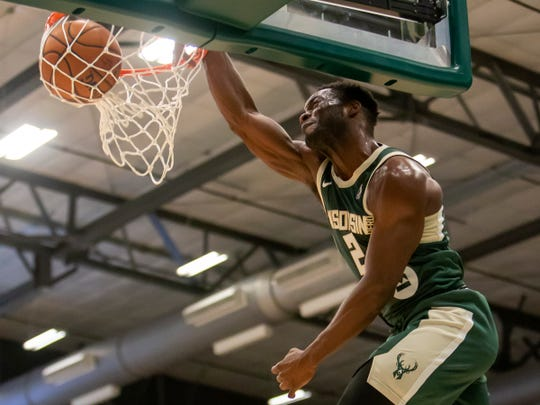 Ike Nwamu of the Wisconsin Herd slams a dunk during the opening game against the Greenboro Swarm at the Menominee Nation Arena Friday, November 2, 2018.