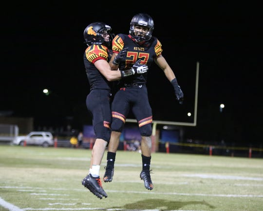 11/02/18 Taya Gray, Special to The Desert SunPalm Desert's Karston Williams, left, and Jordan Garcia, left, celebrate a touchdown by Garcia during their playoff game against Monrovia in Palm Desert on Friday, November 2, 2018.