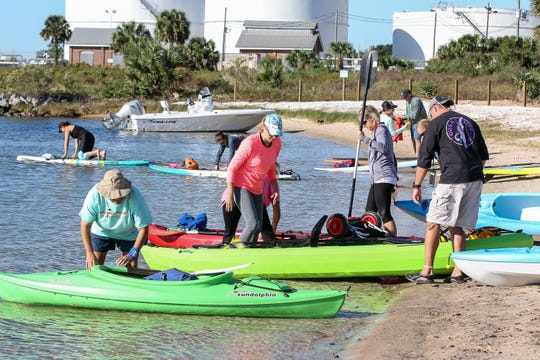 People get their paddleboards and kayaks ready during the Bruce Beach grand re-opening ceremony and paddle fest on Nov. 3.