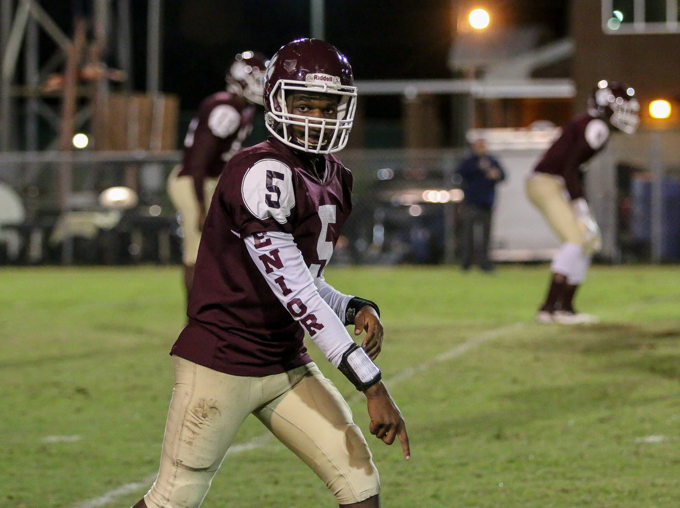 PHS' Ernest Stallworth Jr. (5) checks with an official to make sure he's onside before a play against Escambia in the last game of the regular season on Friday, November 2, 2018, at Pensacola High Schoool.