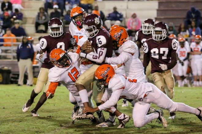 PHS' Ernest Stallworth Jr. (5) drags some Gators with him as he runs against Escambia in the last game of the regular season on Friday, November 2, 2018, at Pensacola High Schoool.
