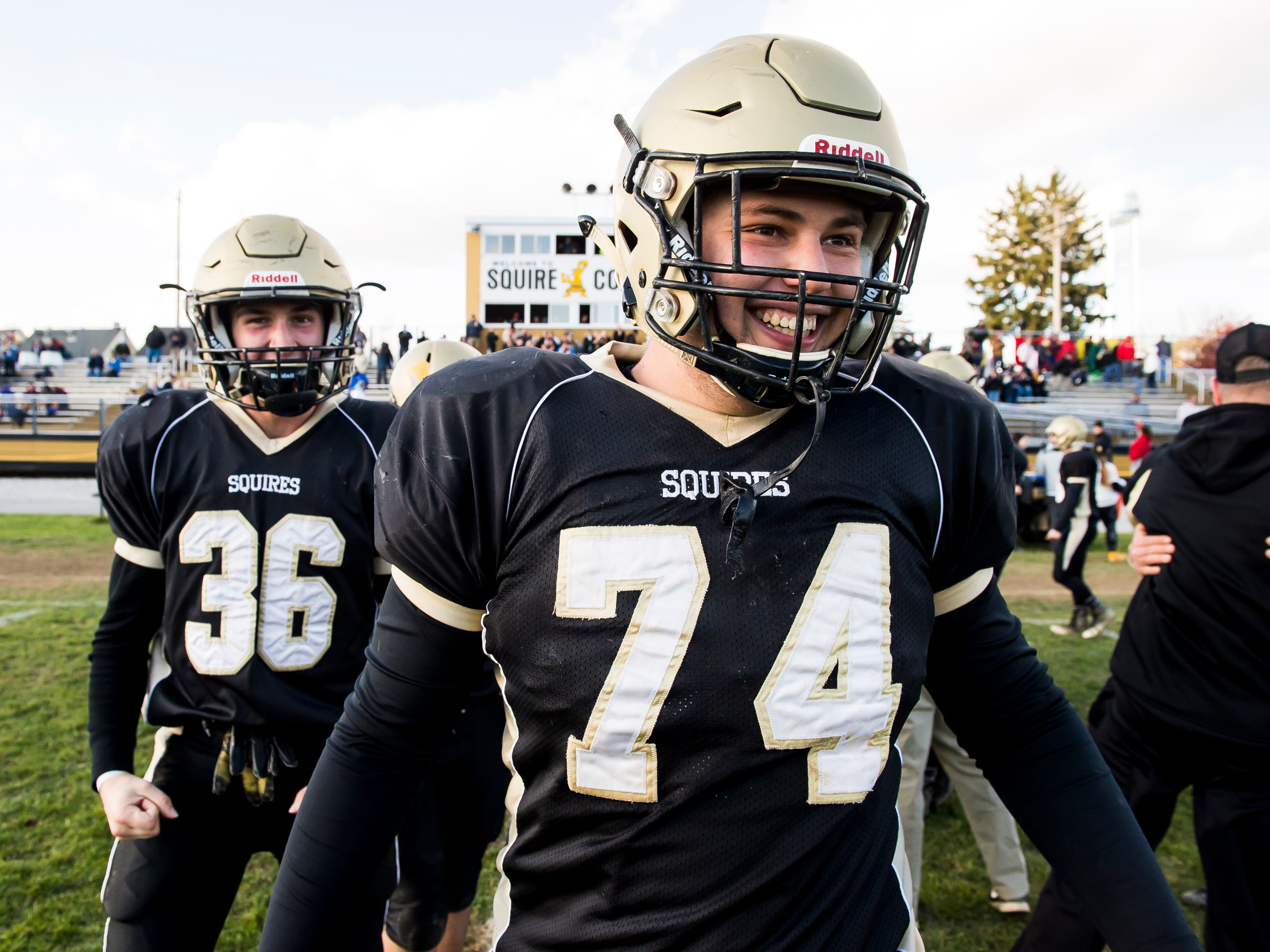 Delone Catholic's Zachary Groft (74) and Ryan Myers (36) smile after defeating Upper Dauphin 48-23 in a District III Class 2A semifinal game on Saturday, November 3, 2018. The Squires will play in the District title game against York Catholic on Friday.