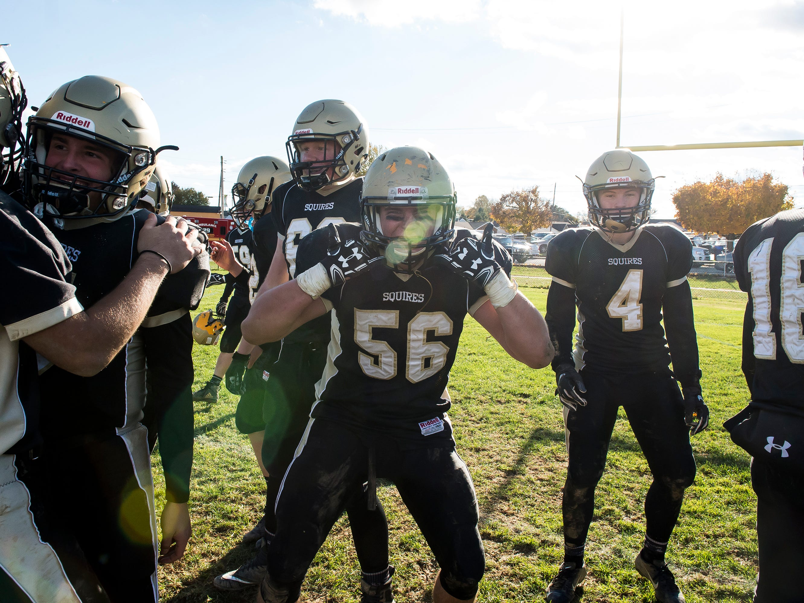 Delone Catholic's Sean Kronner (56) celebrates after defeating Upper Dauphin 48-23 in a District III Class 2A semifinal game on Saturday, November 3, 2018. The Squires will play in the District title game against York Catholic on Friday.