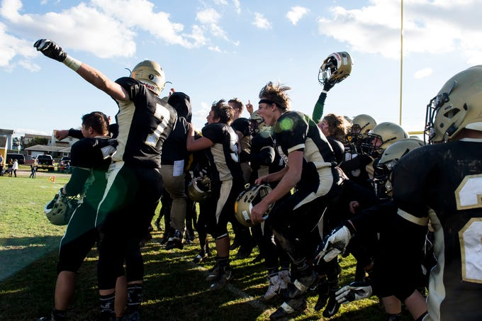 Delone Catholic players celebrate after defeating Upper Dauphin 48-23 in a District III Class 2A semifinal game on Saturday, November 3, 2018. The Squires will play in the District title game against York Catholic on Friday.