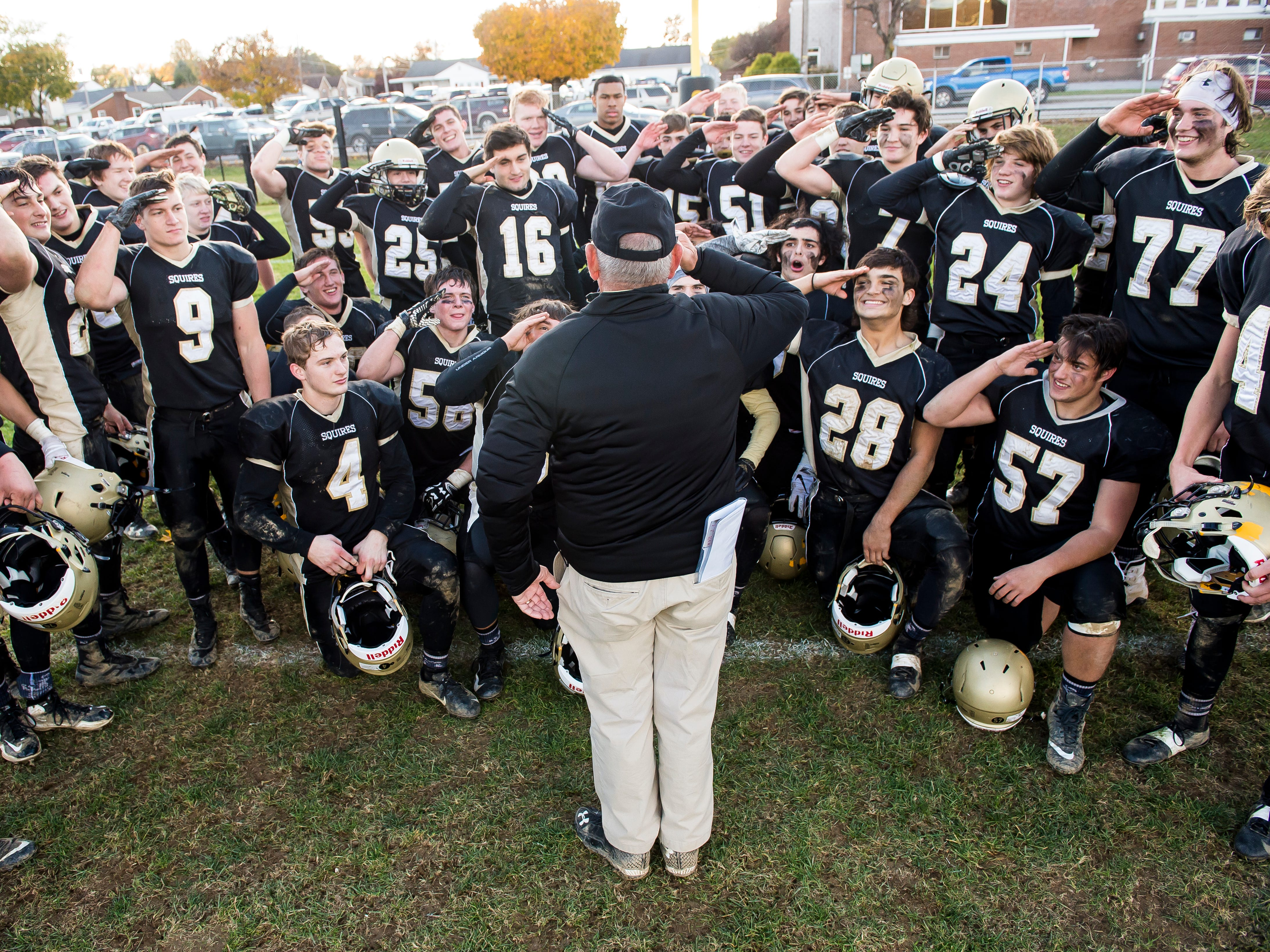 Delone Catholic players salute one of their coaches after defeating Upper Dauphin 48-23 in a District III Class 2A semifinal game on Saturday, November 3, 2018. The Squires will play in the District title game against York Catholic on Friday.