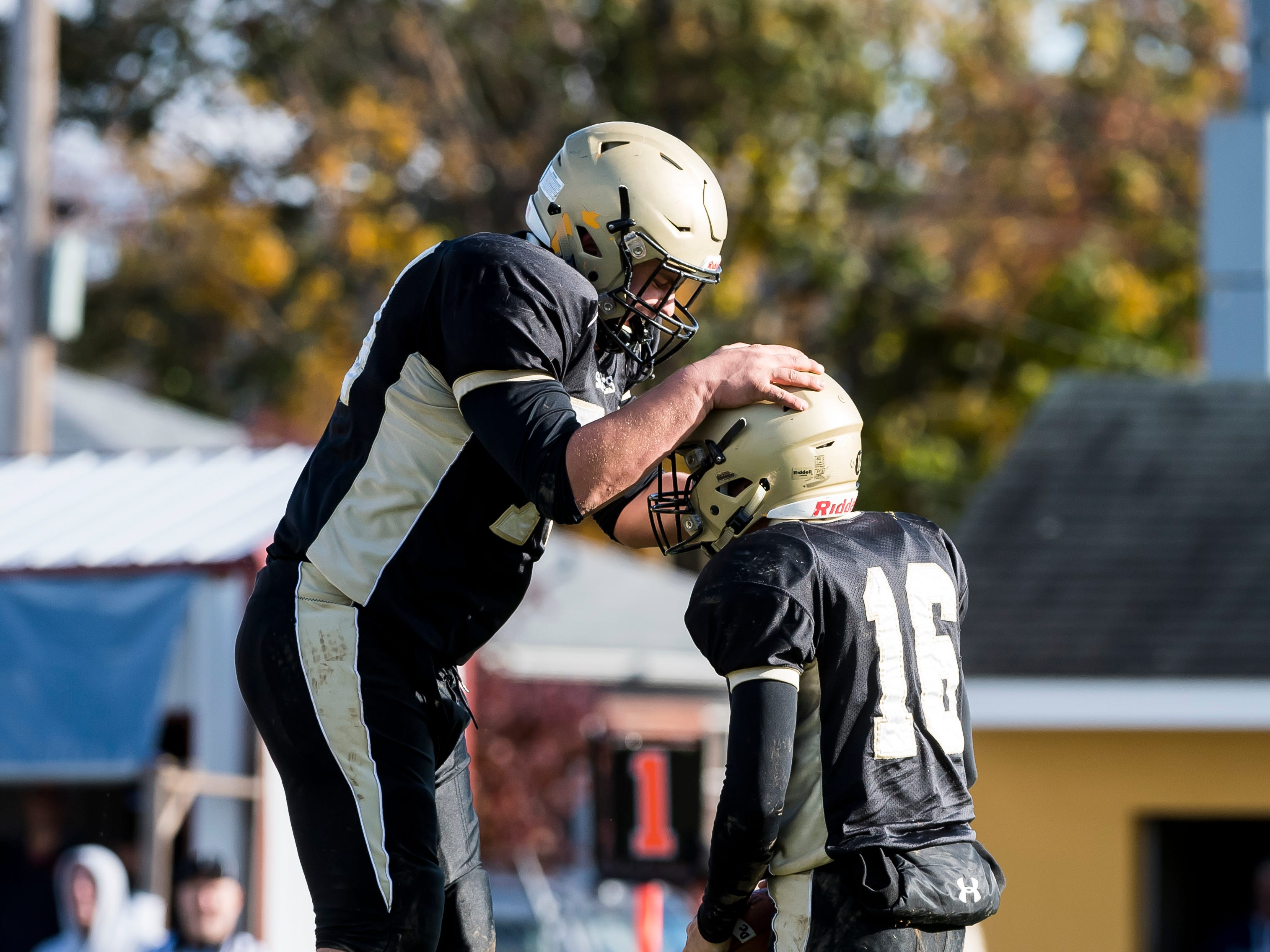 Delone Catholic's Zachary Groft celebrates with Evan Brady (16) after Brady scored a rushing touchdown during a District III Class 2A semifinal game against Upper Dauphin on Saturday, November 3, 2018. The Squires won 48-23.