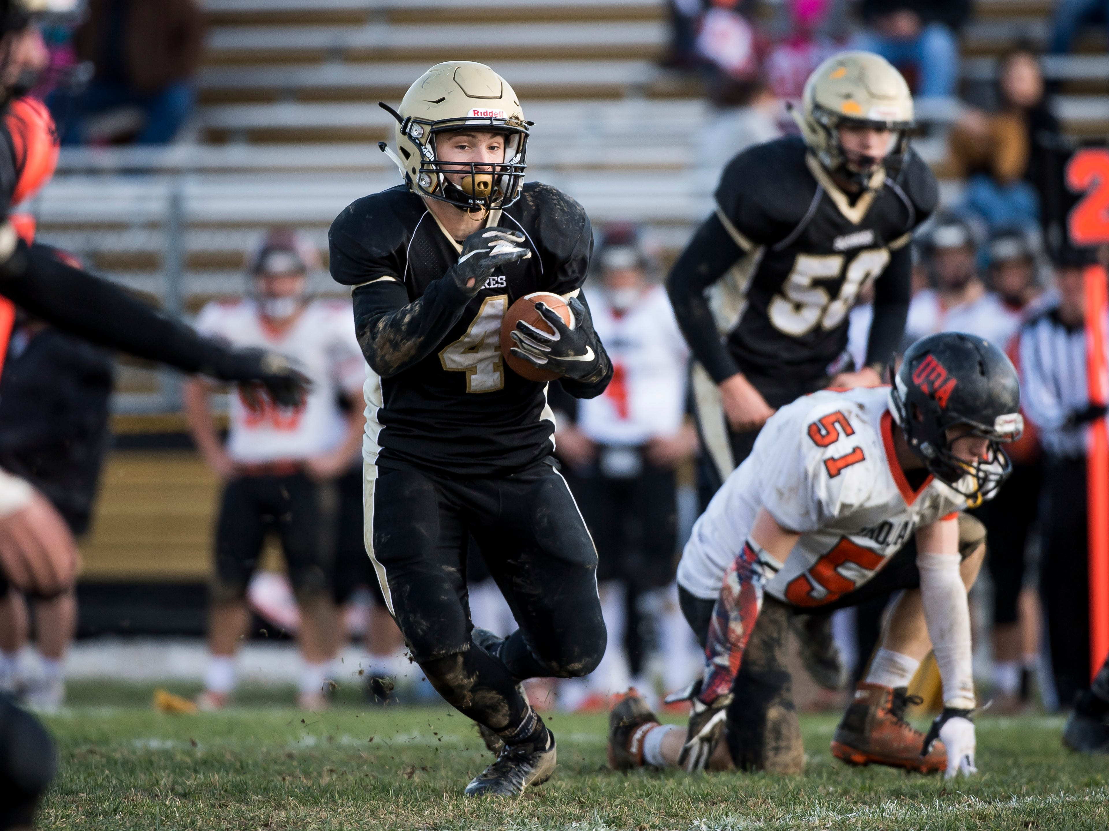 Delone Catholic's Colin Gebhart carries the ball during a District III Class 2A semifinal game against Upper Dauphin on Saturday, November 3, 2018. The Squires won 48-23.